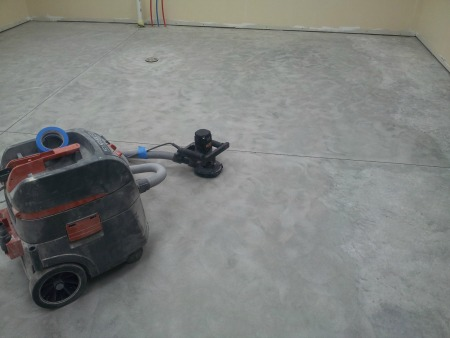 Hand held floor grinder to prep concrete for an epoxy coating