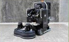 Ride on concrete floor grinder and polisher