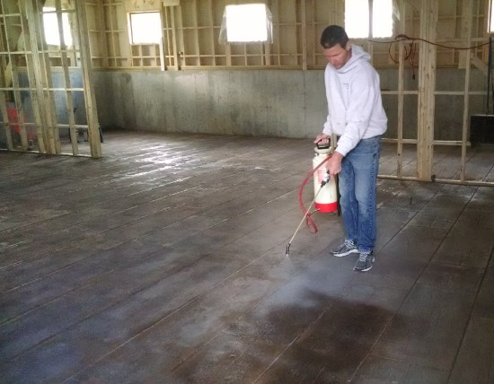 Spraying decorative concrete sealer