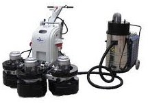 Concrete floor grinder with vacuum attachment